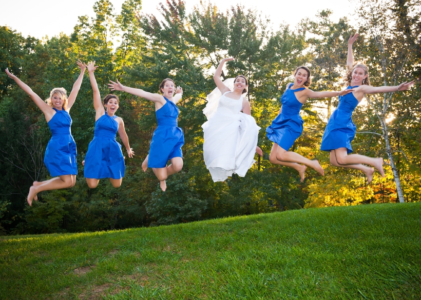 Portrait Of Group Of Bridesmaid And Bride Jumping In Air